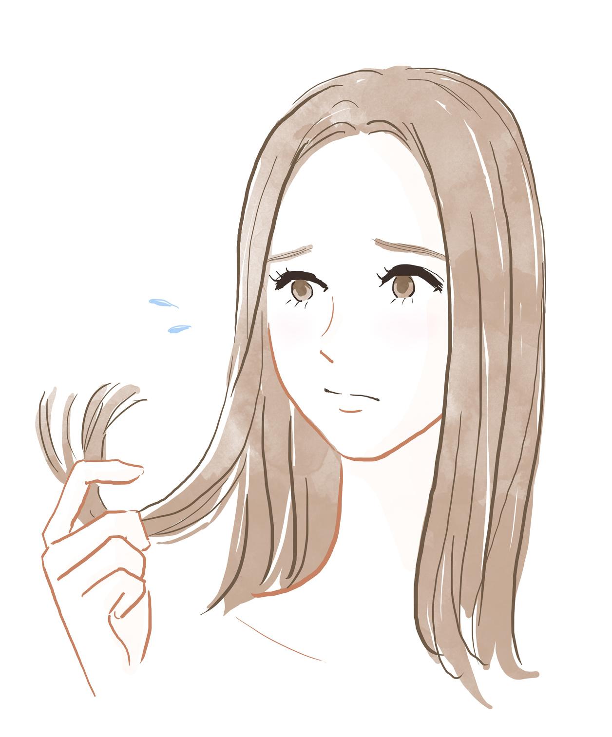 枝毛に悩む女性